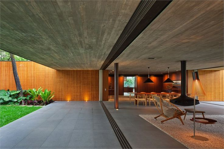 Casa V4, Sao Paulo, Brazil. A beautiful house with wooden elements. Secto 4210 floor light and Secto 4220 table light by Secto Design.