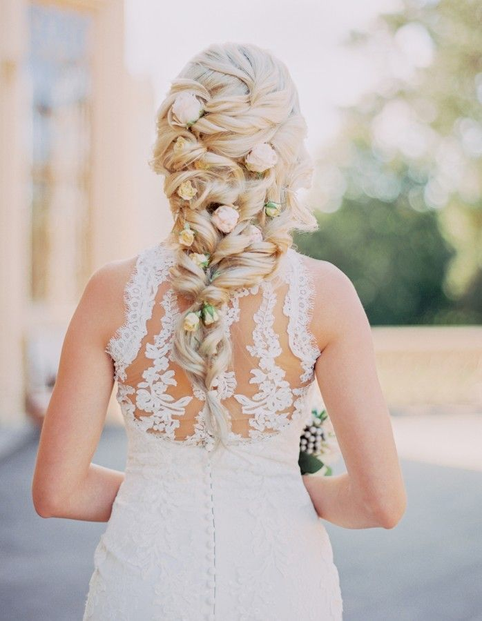 Long blond wedding hairstyle with live roses.