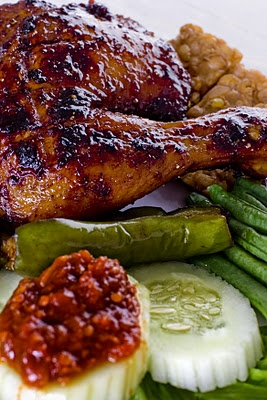 Indonesian food. Grilled chicken with honey sauce and fresh vegetables.