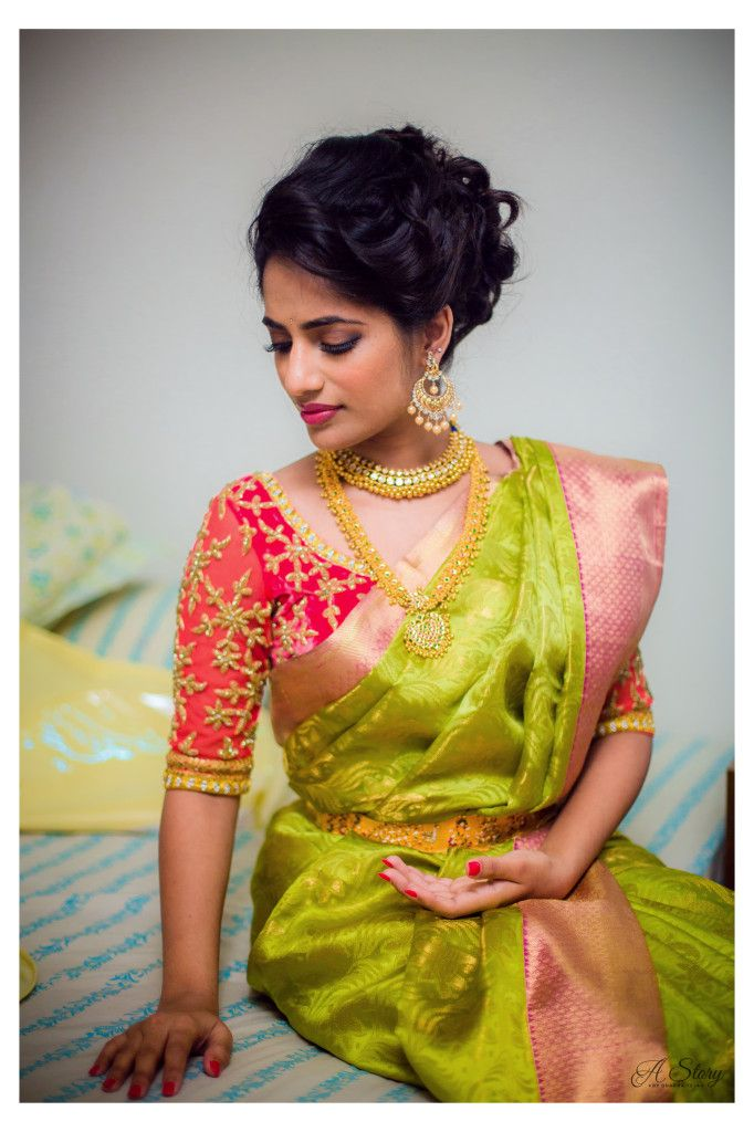 South Indian bride. Gold Indian bridal jewelry.Temple jewelry. Jhumkis. Green yellow silk kanchipuram sari with contrast red blouse.Modern updo.Tamil bride. Telugu bride. Kannada bride. Hindu bride. Malayalee bride.Kerala bride.South Indian wedding.