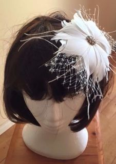 Ivory - Off white feathered flower shaped headpiece with small off the face birdcage veil. Centre has a gold feature button - Suit plain dress or can be worn by mother of bride   Roaring 20's inspired  BUDGET BRIDAL HEADPIECES