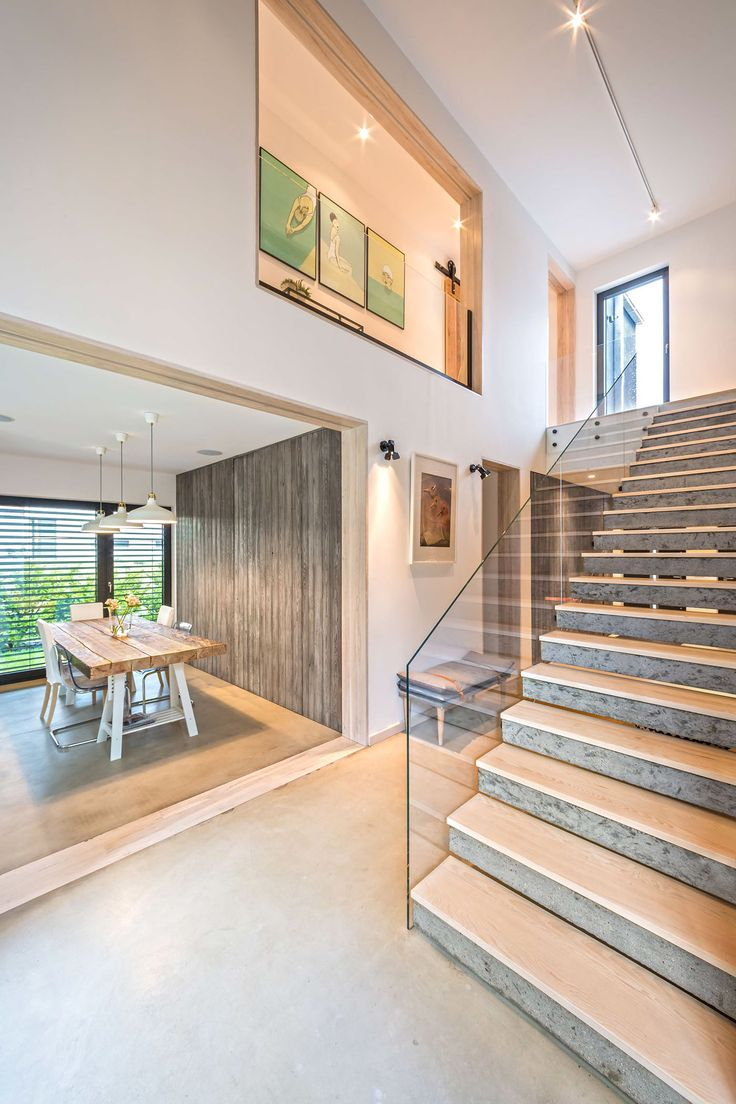 Fancy a modern home in a forest location? This two-storey takes the traditional home, cuts it in half, and adds a legal track car in the centre. Framed by rows