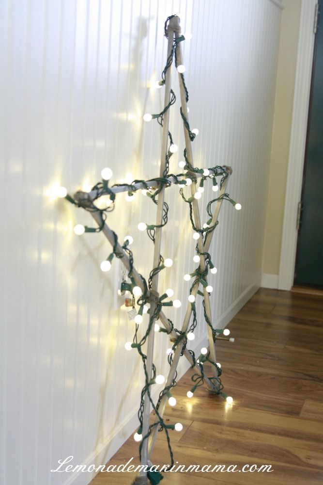 tutorial: how to make an inexpensive rustic star wall decoration (indoor/outdoor) using dowels, hot glue, twine and Christmas lights {Lemonade Makin' Mama} #christmaslightsoutdoorideas