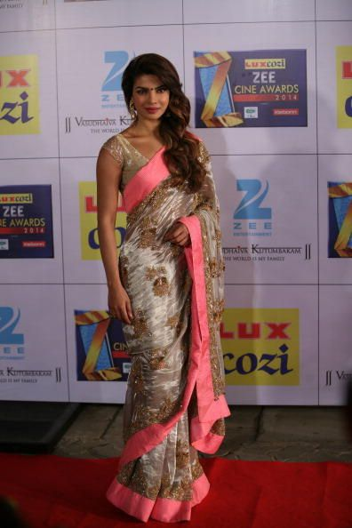 2014's Hottest Red Carpet looks-International Icon award winner Priyanka Chopra opted for the desi route with this sheer tissue sari from JADE with jewellery from Amarapali to great effect.