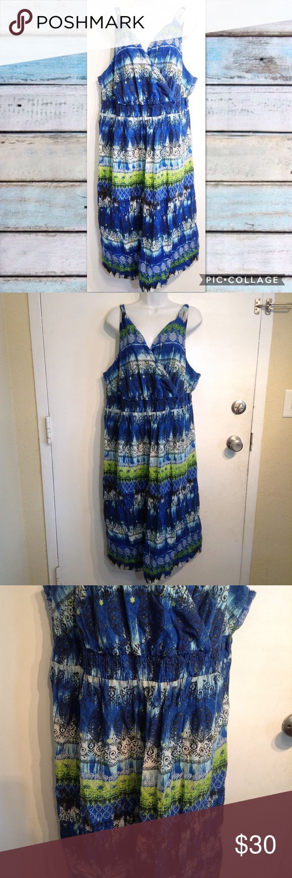 """AVENUE Plus Size Blue Boho Kaleidoscope Dress Avenue plus size blue boho kaleidoscope print dress. Faux wrap style v neck. Shirred elastic back. Flowy bottom. Can be dressed up or down. Size 22/24. Measures 22.5"""" flat from armpit to armpit and 48"""" long. No modeling. Smoke free home. I do discount bundles. Avenue Dresses"""