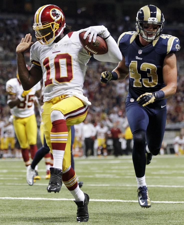 Washington Redskins quarterback Robert Griffin III runs for a touchdown past St. Louis Rams strong safety Craig Dahl Week 2 2012 Season