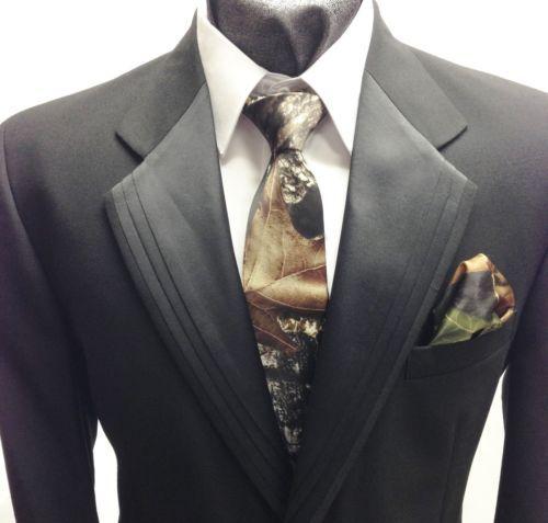 Black jacket, white shirt, camo tie