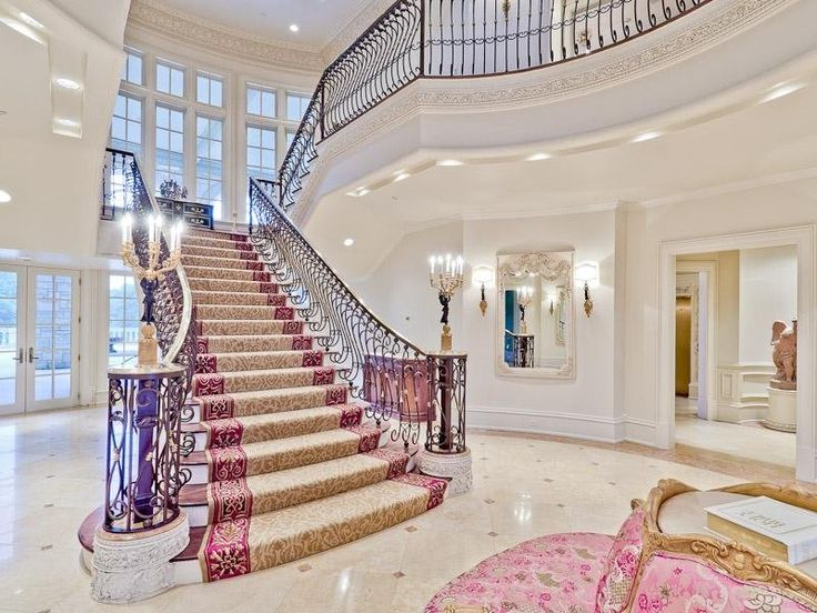 "The grand staircase is something out of a movie. Can't you just imagine Cher from ""Clueless"" walking down that to meet her date?"