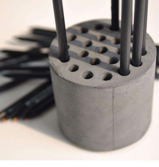 DIY Cement Pencil Holders - This Simplistic DIY Pencil Holder is Punched with Holes Like a Honeycomb (GALLERY)