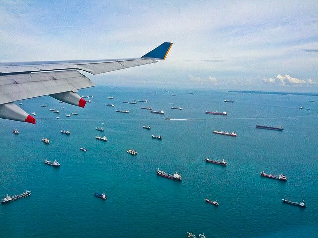 Photo of the Day: Winging it Over the Strait of Malacca | Ships can be seen gliding on the water from an airplane window flying over the Strait of #Malacca on January 21, 2013. (leogaggl/Flickr)