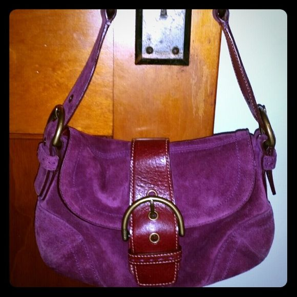 Maroon suede COACH handbag SALES ONLY (-:       - PRICE IS FIRM -  Beautiful maroon suede handbag by COACH ! Only used TWICE ! Great condition ! This specific style of COACH handbag sells for $100 or more ; since it's been SLIGHTLY used I'm selling it for even less !   *------------>BONUS COMES WITH FREE MAKEUP WHEN PURCHASED !!!!!!!!!!!  Two duo eye shadows by elf ( 4 colors total ) . Eye shadow colors include gold , grey , black & purple - all have some sparkle to them !  ---> Brand New…
