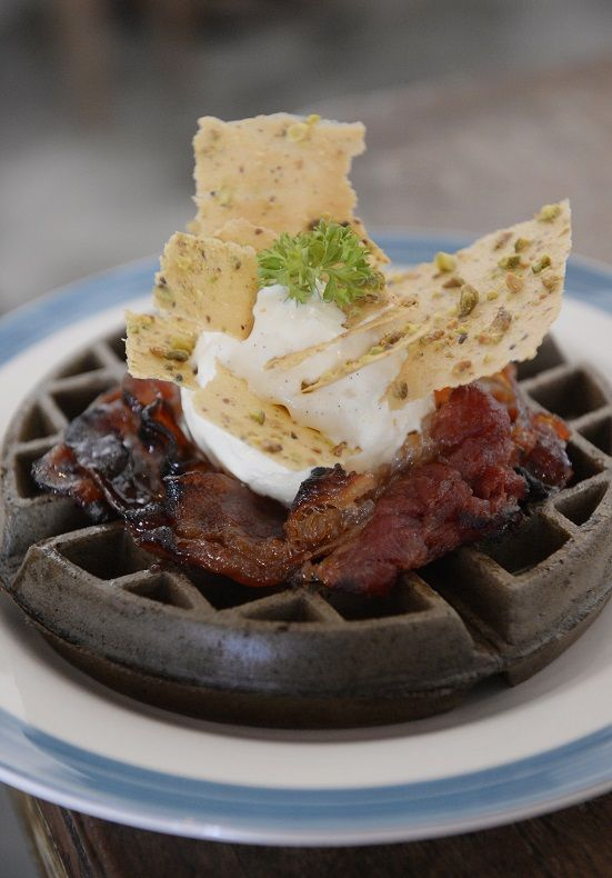 Squid Ink Waffle With Crispy Bacon from Waffle Slayer in Singapore. http://www.straitstimes.com/recipes-food-cooking-tips Photo: Mark Cheong/The Straits Times