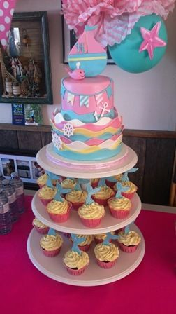 Nautical Themed Baby shower. Cupcakes with Mermaid Tails, Sailboat topper, Baby Whale