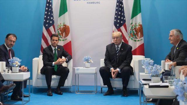El presidente de EE.UU. presiona a su par mexicano para que dejara de decir que México no pagará el muro y le amenaza con aranceles y suspender los contactos.