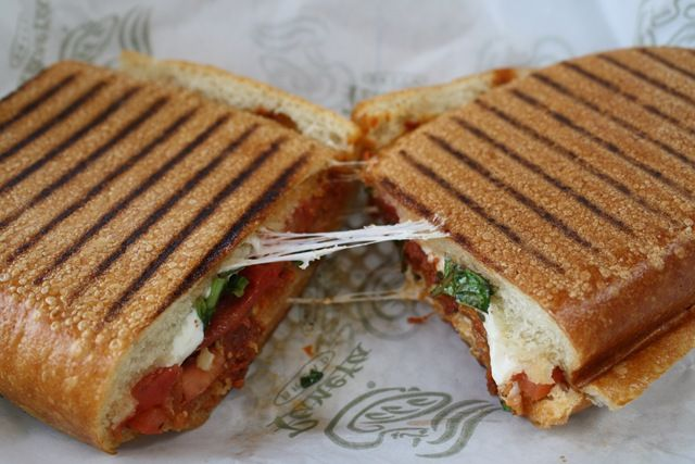 OMG i need to write a recipe to lighten this up.  it's AMAZING.  panera bread's tomato and mozzarella pannini