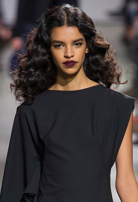 For Zac Posen AW16, the girls repped ringlet curls, brushed and blown out for extra volume, which started close to the root to give a nod to the 1920s. The centre parting accentuates the look, and a slick of poison berry red lipstick brings the winter romance