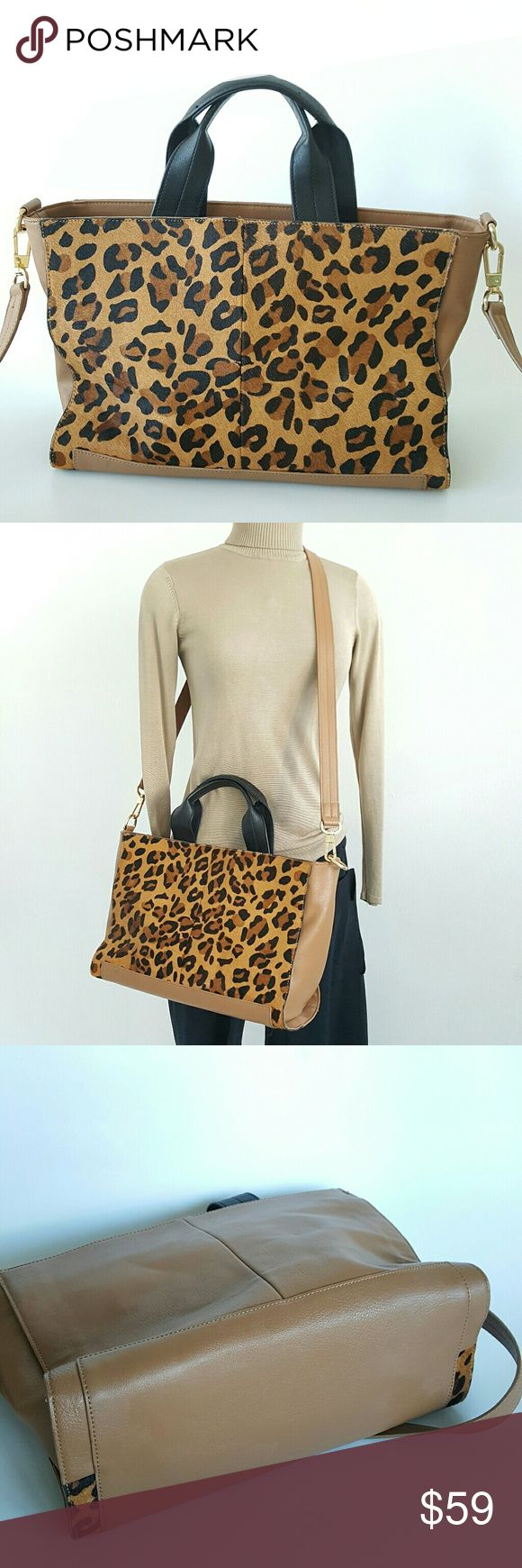 """French Connection Cow Hair Fur Tote/Crossbody Perfect for shopping or work,  will fit perfectly computer,  accents of cow hair fur with leopard print,  back is 84% of PU,  lining cotton navy blue. Magnetic snap closure, interior zip pocket and two additional pockets for cell phone and key. Excellent condition, very clean interior. Dimensions are 15"""" x 5"""" x 9"""" French Connection Bags Totes"""