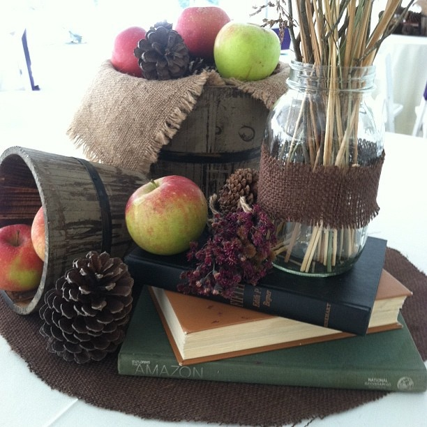 Apple And Pinecone Centerpiece With Vintage Books Burlap Inside Of Bushel My Wedding Day