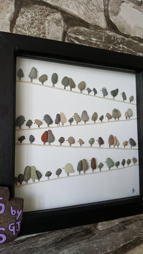 Heres a pebble art picture with little pebble birds representing age The one in …