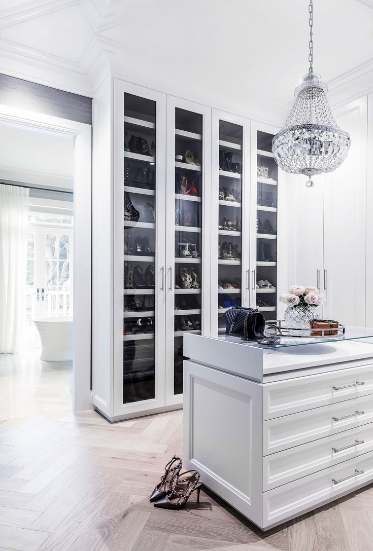 Walk-in wardrobe from a luxurious Hamptons style home in Sydney's Eastern Suburbs. Photo: Maree Homer