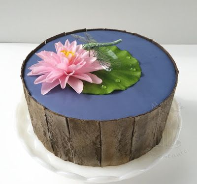 Wafer paper water lily and dragonfly from gumpaste, wood effect on fondant