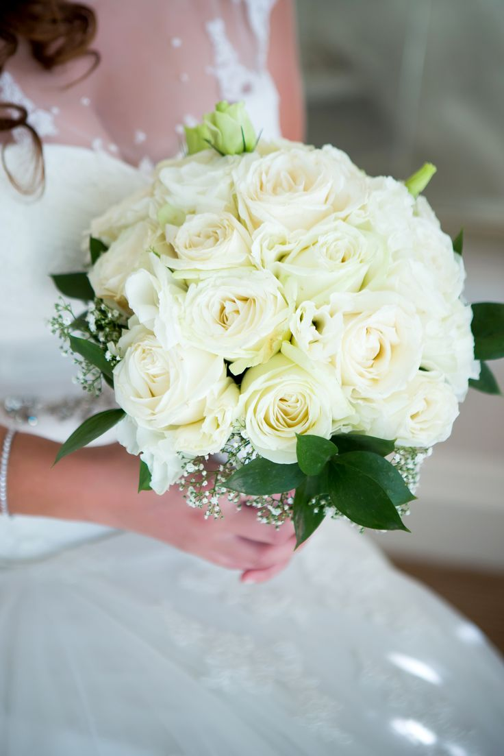 Hand tied white avalanche roses, lisianthus, million star and ruscus collar bouquet. Thanks to Tracy Robertson Photography