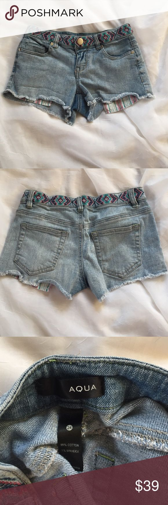"""Aqua denim cutoff shorts, size 24 Aqua Jean shorts in a size 24. Striped peekaboo pockets and an embroidered waistband are features. Waist is 26"""", rise 7"""", and total length 8"""". I do not model or trade. 🦊 Please use measurements provided and ask any questions prior to purchasing. I want happy customers. 😊 Aqua Shorts Jean Shorts"""