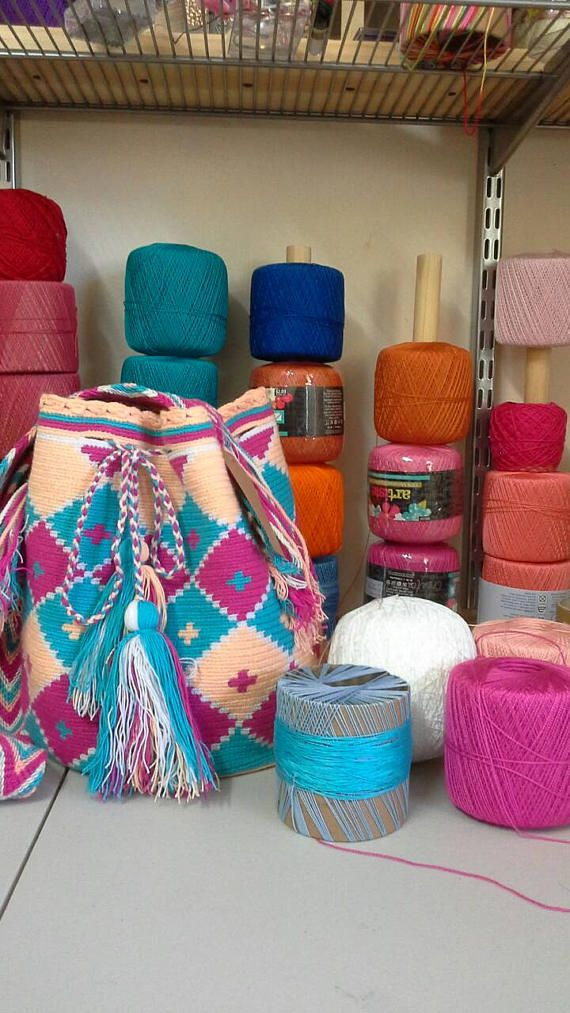 Check out this item in my Etsy shop https://www.etsy.com/listing/527192423/colombian-wayuu-mochila-bag-handmade