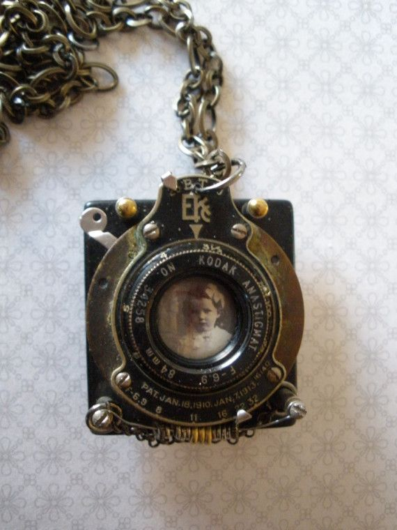 Camera Girl Mixed Media Necklace. Like the camera mechanism. Keep my eye open for some cameras or parts.