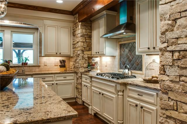 Gorgeous Stone Wall Kitchen With White Cabinets Mls