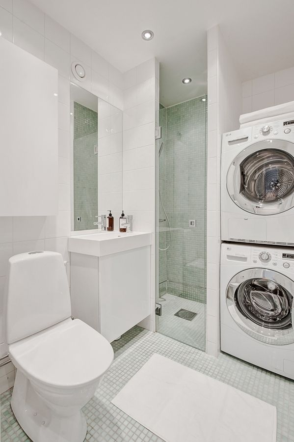 shower and laundry machine side by side