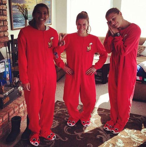 Tobin Heath, Kelley O'Hara, and Alex Morgan in onesies. Favorite trio.