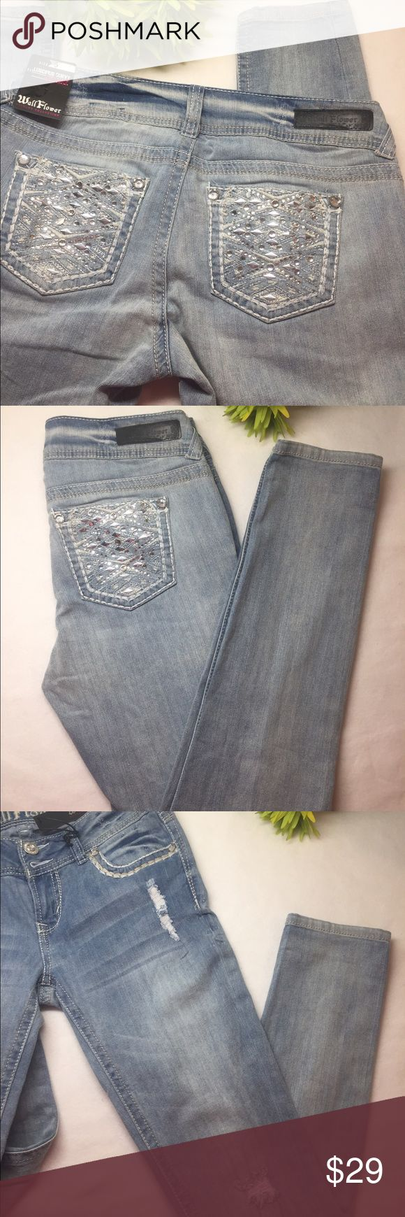 "Embellished/Distressed Skinny Jeans Showcase your sassy sense of style with these Junior's Wallflower curvy skinny jeans. Light blue wash with silver embellishments on back pockets; stitching around from pockets and distressed front provides the ultimate glam to any ensemble.  *Featured in light blue wash *Slight stretch  *5-pocket; Double button fly *Contour waist band prevents gapping *Tight through knee *Made of 99% cotton; 1% spandex…Machine washable *Measurements: Waist=28""…"