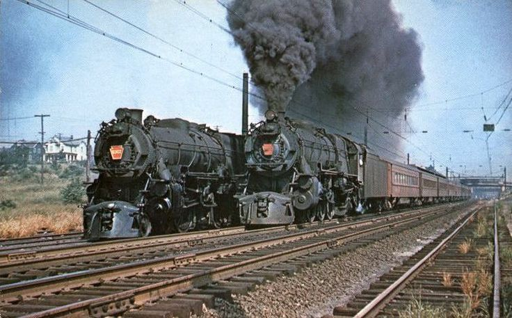 """The Pennsylvania Railroad or Pennsy's K4 class 4-6-2 """"Pacific type"""" built 1914–1928 was its premier passenger-hauling steam locomotive from 1914 through the end of steam on the PRR in 1957.   Here 5406 and 5367 are seen a year before the final year with trains at South Amboy, New Jersey."""