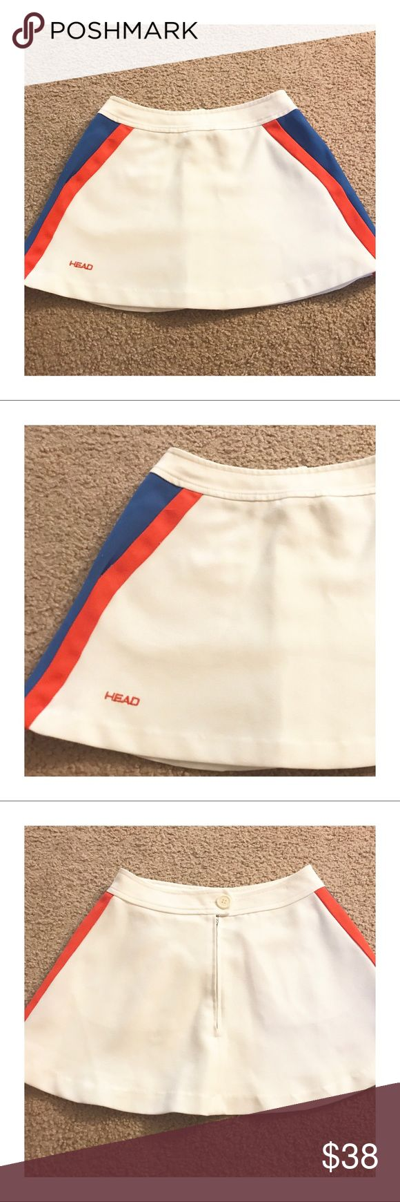 """1980's Super Mini Head Tennis Skirt!!! 😍 1980's Super Mini Head Tennis Skirt, Vintage Tennis Skirt by Head, Red, white & blue! 24"""" Waist, XS  Best tennis skirt in my collection!   Maybe! But probably :)  Straight outta the 1980's, this tennis skirt is totally legit. White with red and blue side stripes & closes in the back via plastic zip and one button  Fantastic condition as you can see  The waist measures 24"""" Length is an itty bitty 13"""" 🐯 Head Skirts Mini"""