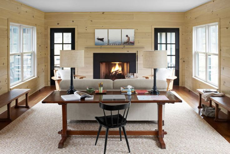 A triptych of lake photographs by David Hilliard establishes a laid-back mood above this Connecticut home's fireplace.    - CountryLiving.com