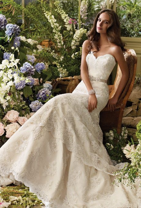 Brides: Tara Keely :  2206  Ivory alencon lace gown with elongated bodice and scalloped tiered skirt, strapless sweetheart neckline. Ribbon belt with beaded applique at natural waist, and chapel train.