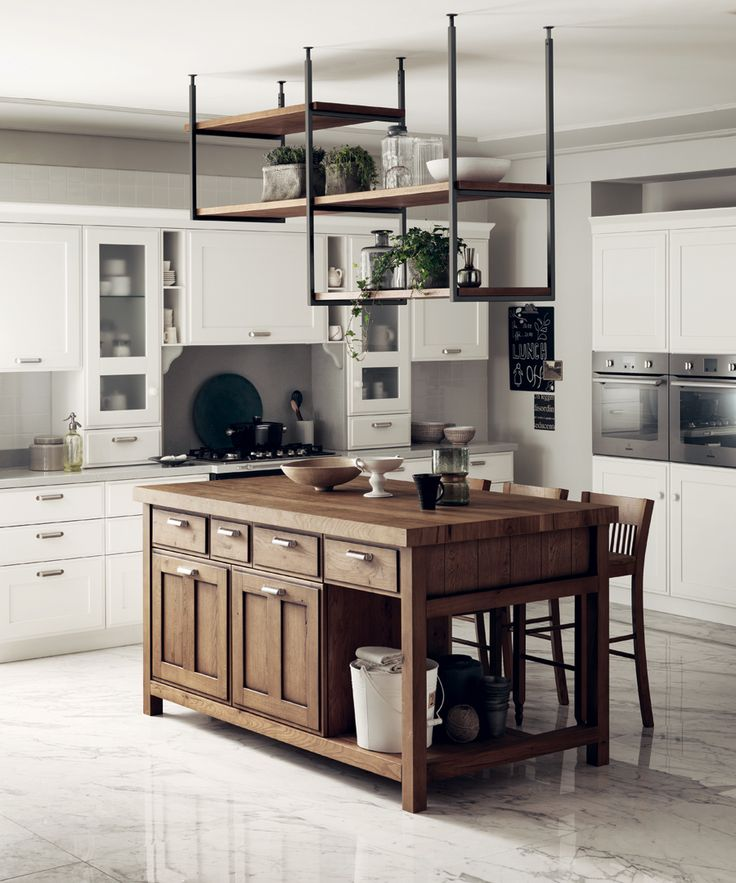 Composition devised to reinterpret country style kitchens through strikingly simple yet stylish features, which are also perfect for a city home. The Favilla island block in Nodato Oak catches the eye and blends in perfectly with the Favilla hanging rack, a truly unique and concurrently functional detail. Shabby chic kitchen ideas.