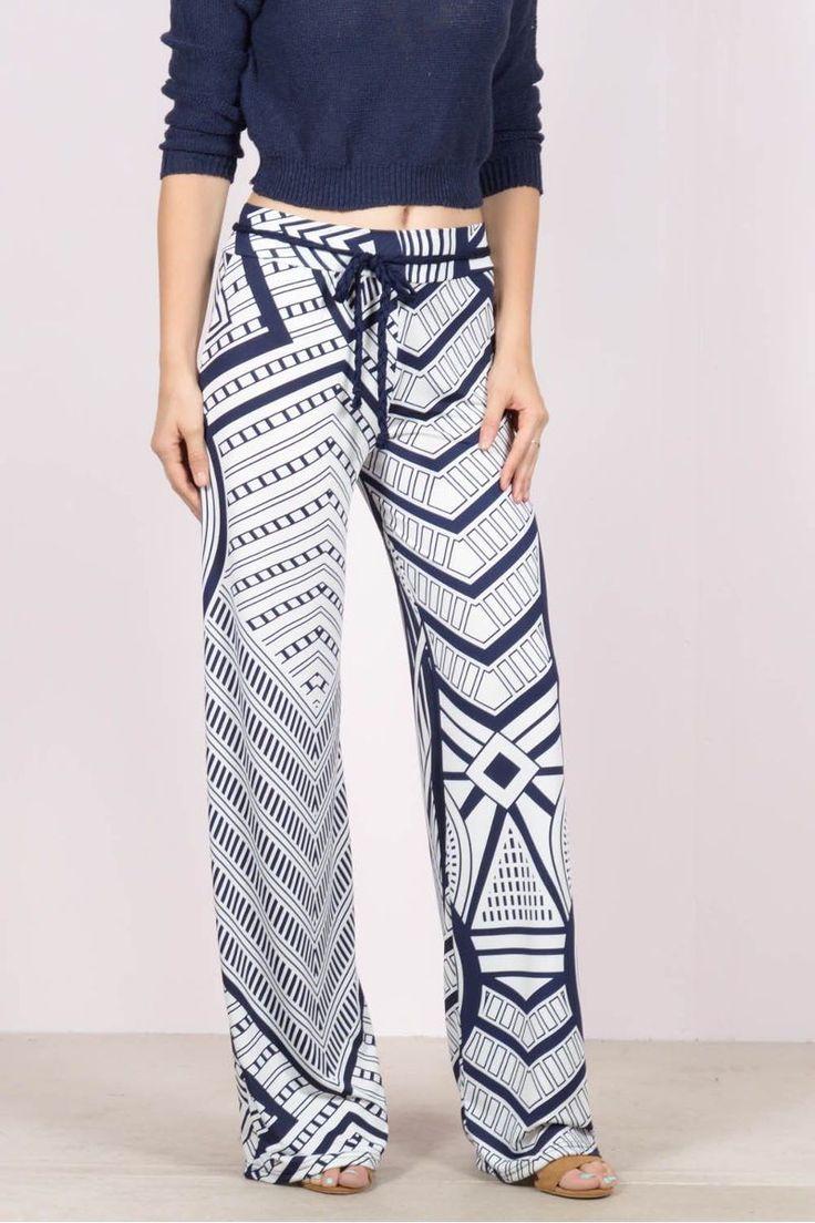 Εμπριμέ παντελόνα με ζωνάκιeXXes.Ύψος μοντέλου: 1,78m94% Polyester 5% Spandex