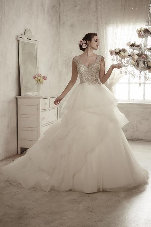 Balletts Bridal - 22764 - Wedding Gown by Jacquelin Bridals Canada - Layers of tulle overlap in a full skirt with train under a bodice with gemmed straps and bejeweled sweetheart neckline. Complete with a zipper back overlain with bead buttons and loops.