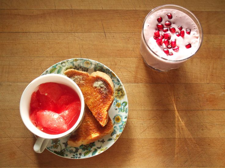 grapefruit, whole wheat toast with earth balance, protein smoothie with soy milk, raspberries, soy protein isolate, cane sugar, and pomegranate seeds