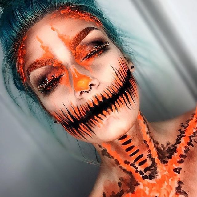 "October 25th! Jack-o'-Lantern  Can't believe we are in the last week of this already!  Thanks again for all your love and support, it's so amazing ❤️ I used: @maccosmetics ""black black"" chromacake @stargazerproducts uv neon orange paint(I do NOT recommend this around the eye area, it burns and made my eyes streeeeam!) @katvondbeauty MiVida Loca palette @anastasiabeverlyhills dipbrow pomade in ebony @sparklepigglitter Halloween lashes, these were THE EASIEST lashes to apply out of any....."