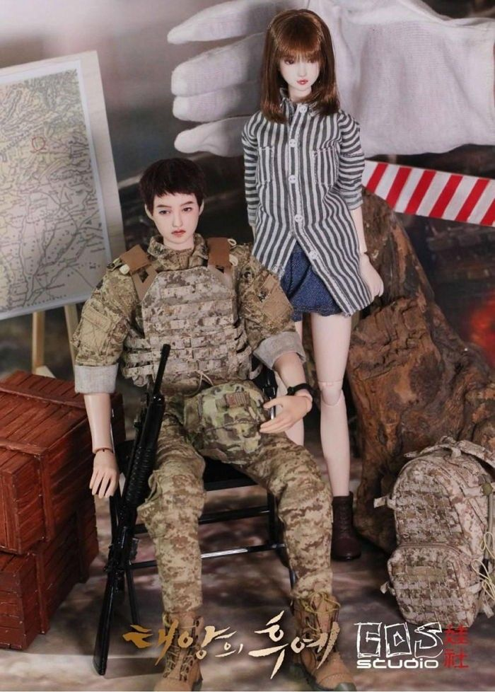 "How far would you go to show your devotion to something? Say, your favorite drama? Recently in an online community, one Chinese fan of the ultra-popular drama ""Descendants of the Sun"" has been garnering a whole lot of attention thanks to a photo going around. The photo in question is of a set of dol..."
