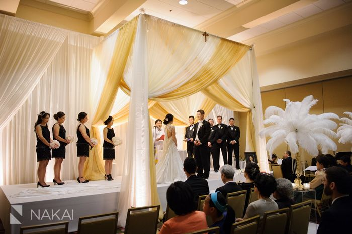 Lincolnshire Marriott Wedding Photos - Great Gatsby Theme! Creative wedding ceremony ostrich feathers gold candleabras! Vale of Enna Floral design- Picture by Chicago Wedding Photographer - Nakai Photography http://www.nakaiphotography.com