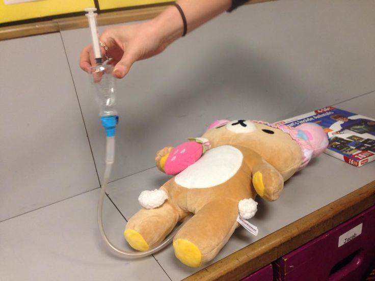 Medical prep for enema. Loose parts: syringe, tubing, plastic bottle