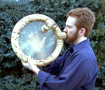 Didjibodhrán    The didjibodhrán is an original hybrid instrument. It's an Irish frame drum, called a bodhrán, that has a stretched goatskin head. The ceramic drum frame is also a circular didjeridu. When blowing into the didjibodhrán as a didjeridu, the drum head vibrates sympathetically, creating some eerie pseudo-reverberation effects.