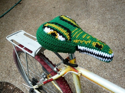 Yarn bomb  boom.  crocheted seat cover.  awesome.