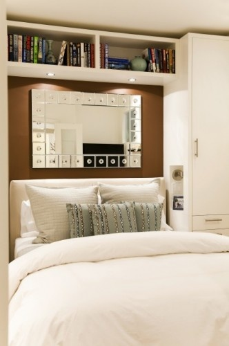 built-ins on both sides of bed, with shelving unit bridge joining them. lighting underneath. built ins could go around a window.