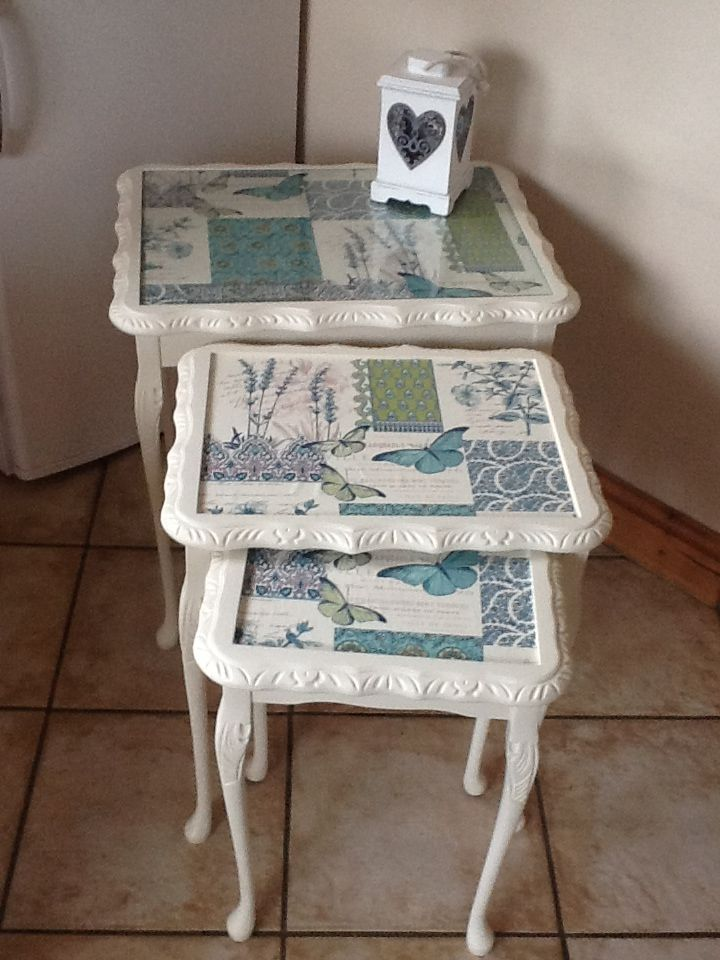 Gorgeous nest of tables upcycled with country cream chalk paint, waxed and then decorative wallpaper added for the finishing touch