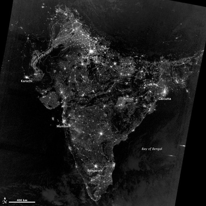 """On November 12, 2012, the Visible Infrared Imaging Radiometer Suite (VIIRS) on the Suomi NPP satellite captured this nighttime view of southern Asia. The image is based on data collected by the VIIRS 'day-night band,' which detects light in a range of wavelengths from green to near-infrared. The image has been brightened to make the city lights easier to distinguish."""